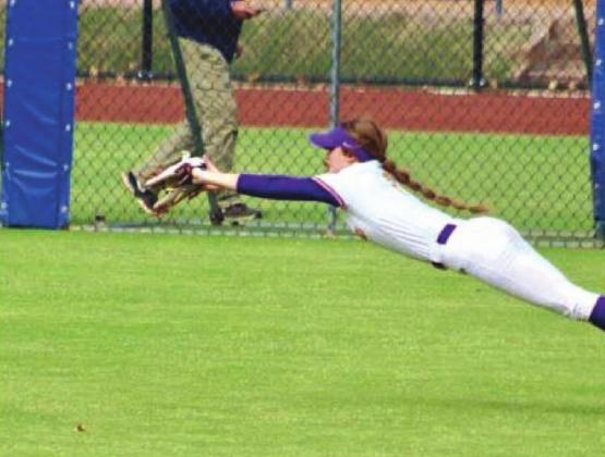 Kinzie Williams with the full layout catch for an out. courtesy photo